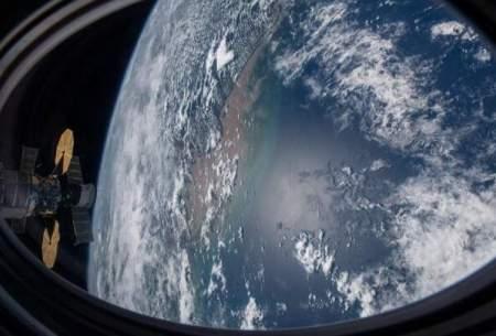 تصویر ایستگاه فضایی بینالمللی بر فراز اقیانوس