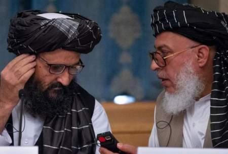 ملا عبدالغنی برادر، معاون سیاسی طالبان(چپ) و شیر محمد عباس استانیکزی، مذاکره کننده ارشد طالبان